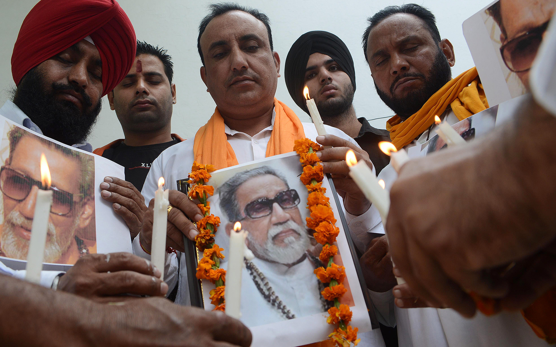 Members of the Indian Hindu nationalist Shiv Sena party light candles as they pay tribute to chief of the Hindu nationalist Shiv Sena party, Bal Thackeray in Amritsar on November 18, 2012.