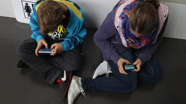 Kids obsessed with smartphones