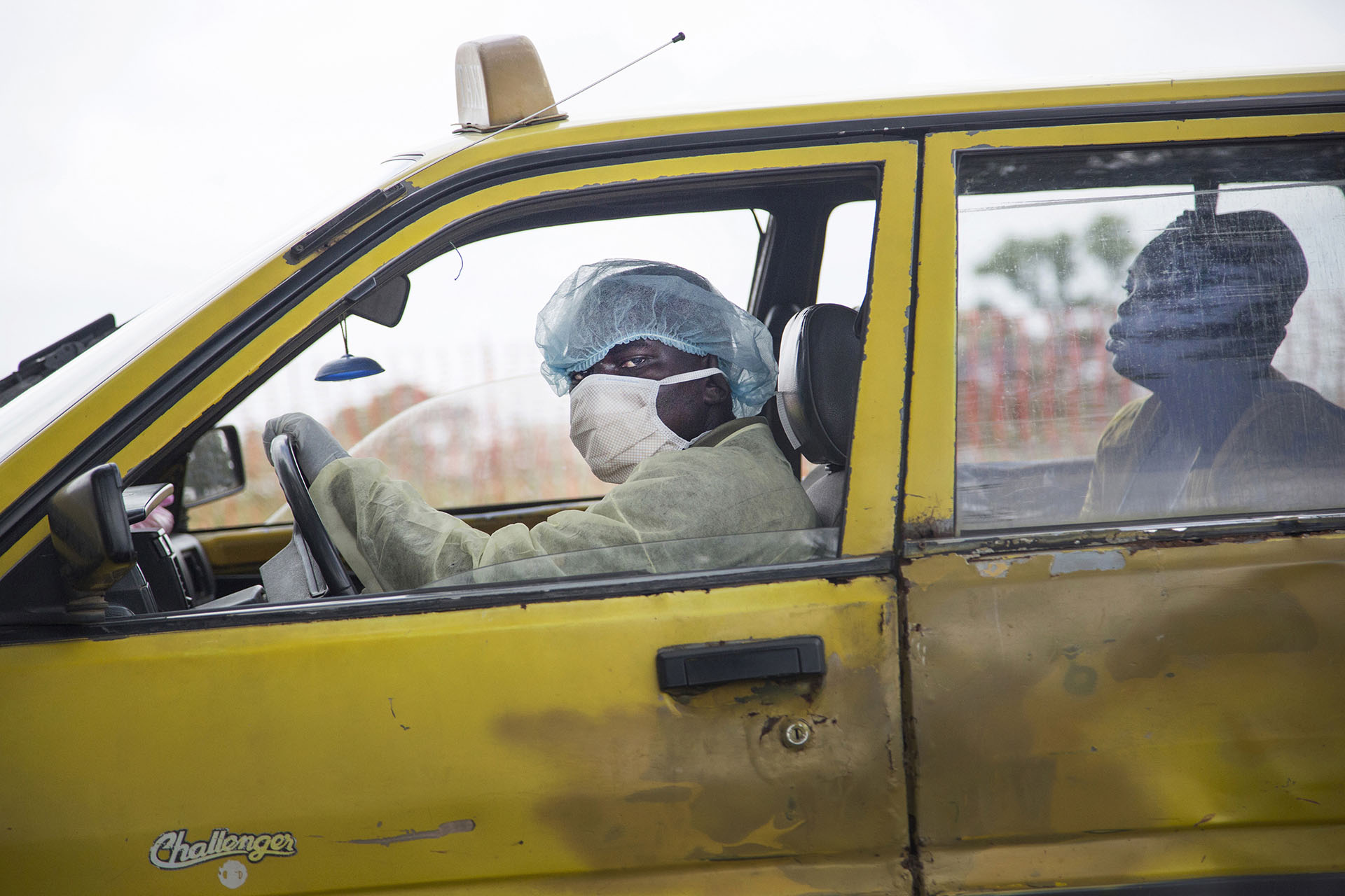 http://mashable.com/2014/10/24/ebola-liberia-hell-photographer/