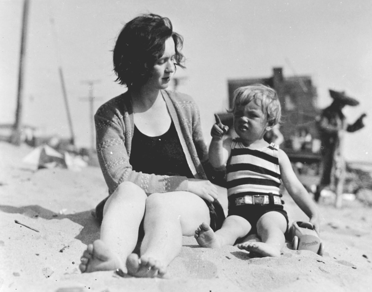 A young Marilyn Monroe with her mother at the beach